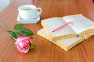 pink rose with book and coffee © kitzcorner - Fotolia.com